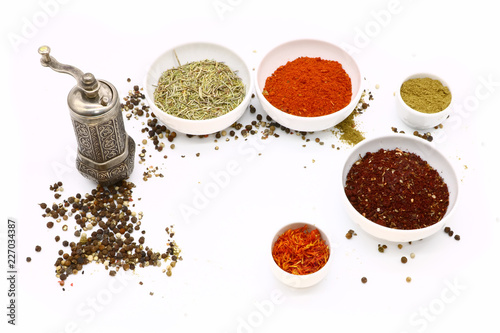 Canvas Prints Spices different spices in a white ceramic cup and mill for spices, isolated