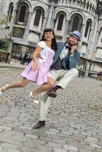 A Couple Of Lovers Dressed Retro Style Dancing  In The Streets Of Montmartre, Paris, France