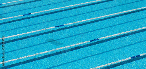 Swimming pool with blue water for sporting swimming with tracks, swim lanes in o Canvas Print