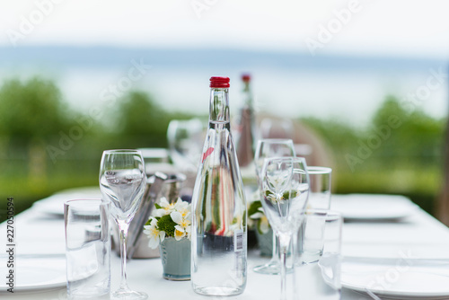 glass of water and bottle on table