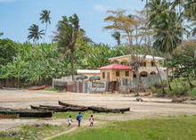 Fishing Village On The Sea In Sao Tome And Principe. Mountains Like Pico Cão Grande. Travel To Sao Tome And Principe. Beautiful Paradise Island In Gulf Of Guinea. Former Colony Of Portugal.