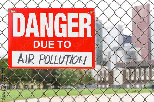 3379fe4920ba Sign danger due to air pollution hanging on the fence - Buy this ...