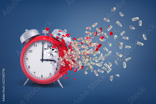 3d rendering of a large red retro alarm clock stands partially crumbled with its pieces turning into dollar bills Fototapet