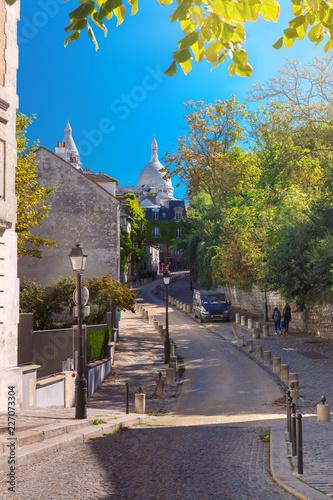 Foto op Plexiglas Historisch geb. Cozy old street and Sacre-Coeur Basilica at the sunny summer morning, quarter Montmartre in Paris, France
