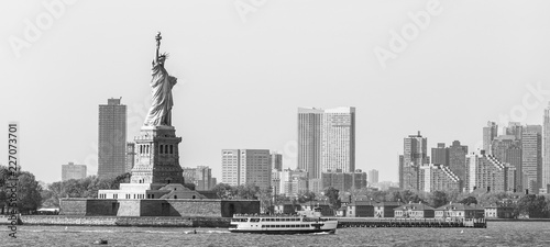 Keuken foto achterwand New York City Statue of Liberty with Liberty State Park and Jersey City skyscrapers in background, USA. Black and white image.