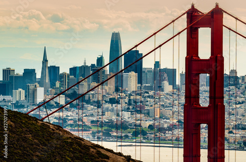 City of San Francisco Ca. Downtown business district seen through the north tower of the Golden Gate Bridge
