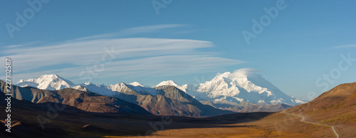 Long golden valley in front of snowy Denali in Autumn