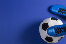 Soccer Ball Under Soccer Players Feet On Blue Background