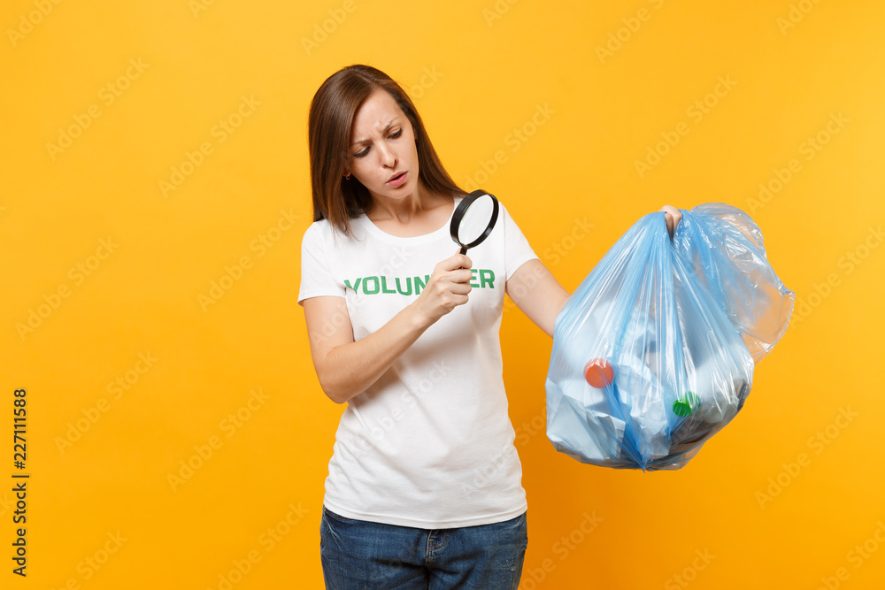 Fototapeta Woman in t-shirt volunteer, trash bag isolated on yellow background. Voluntary free assistance help, charity grace. Environmental pollution problem. Stop nature garbage environment protection concept.