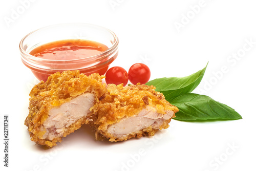 Fotografía  Fried Tasty Crispy Breaded Chicken Nuggets with basil leaves and spicy sauce, close-up, isolated on a white background