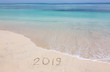 Happy New Year 2019 creative on the beach