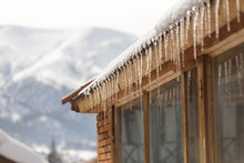 Winter Icicles Hanging From Ea...