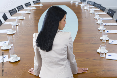 Businesswoman at head of boardroom conference table Wallpaper Mural