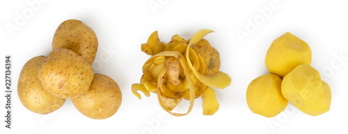Fotografía  Three piles of potatoes, peeled and peeled potatoes on a white, isolated