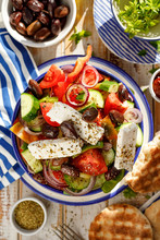 Greek Salad. Traditional Greek Salad Consisting Of Fresh Vegetables Such As Tomatoes, Cucumbers, Peppers, Onions, Oregano And Olive Oil, Top Viewl. A Delicious And Healthy Vegetarian Dish