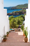 Fototapeta  - Ibiza, typical staircase with view on the sea