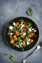 Pumpkin Salad With Beetroot, Arugula And Feta Cheese.Top View.