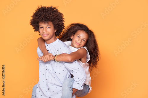 Happy brother and sister with afro hairstyle Canvas Print