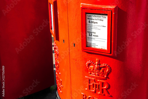 Close-up view of a old traditional vintage classic red letter box or postbox standing on sidewalk in London, Brighton and England Wallpaper Mural