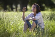 Thoughtful Mature Woman Sittin...