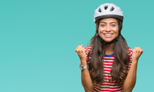 Young Arab Cyclist Woman Wearing Safety Helmet Over Isolated Background Celebrating Surprised And Amazed For Success With Arms Raised And Open Eyes. Winner Concept.