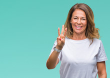 Middle Age Senior Hispanic Woman Over Isolated Background Showing And Pointing Up With Fingers Number Three While Smiling Confident And Happy.