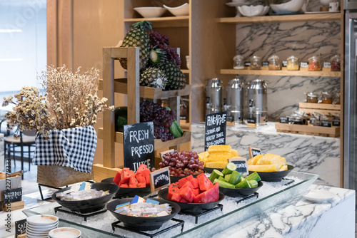 Healthy fresh breakfast fruit in restaurant hotel with grapes, watermelon and pineapple prepare for fresh pressed juice.