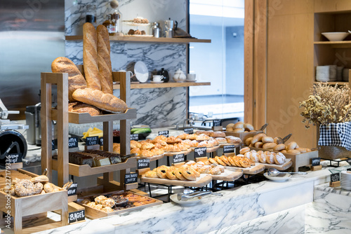 Poster Boulangerie A variety of fresh homemade bread and bakery corner in luxury hotel breakfast buffet, restaurant interior.