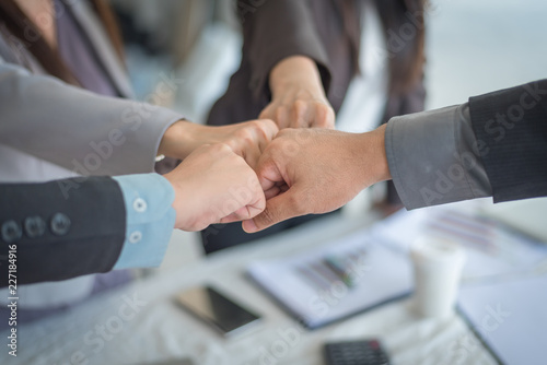 Teamwork Join Hands, Close-up of business partners making pile of hands at meeting, business concept Wallpaper Mural