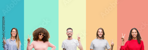 Photographie  Collage of group of young people over colorful vintage isolated background showing and pointing up with fingers number two while smiling confident and happy