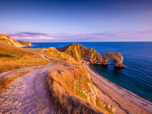Sunset Over Durdle Door - The Most Famous Landmark In Devon England