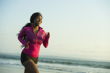 Young Happy And Attractive African American Runner Woman Exercising On Running Workout At Beautiful Beach Jogging And Enjoying Sunset In Outdoors Activity Fitness Concept