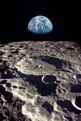 Earth rises above lunar horizon. Elements of this image furnished by NASA.