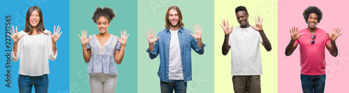 Photo Composition of african american, hispanic and chinese group of people over vintage color background showing and pointing up with fingers number ten while smiling confident and happy