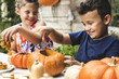 canvas print picture - Young kids carving Halloween jack-o'-lanterns
