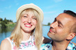 Lovers man and woman rest in a tropical country. Holiday romance, love, happy people