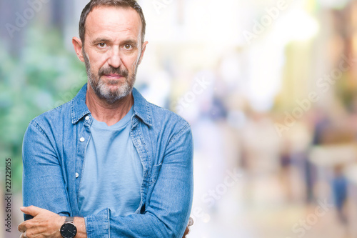 Fotografiet  Middle age hoary senior man over isolated background with serious expression on face