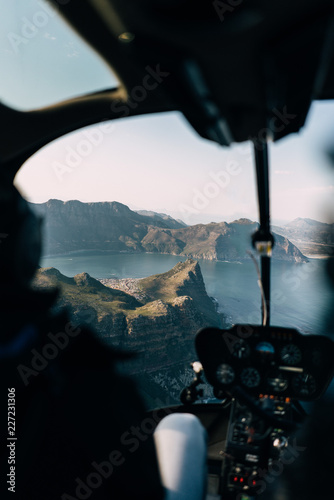 view from helicopter on coastline and mountain range