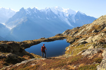 Hiker Looking At Lac Des Chese...