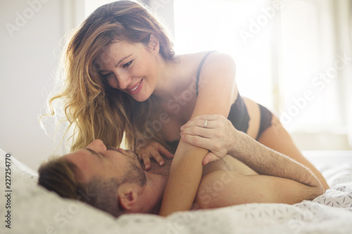 Fotografia, Obraz Attractive couple sharing intimate moments in bedroom