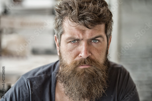 Canvastavla  Man brutal bearded hipster thoughtful mood defocused background