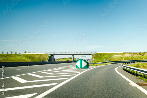 French autoroute highway exit on the right with security differentiator and over Canvas Print