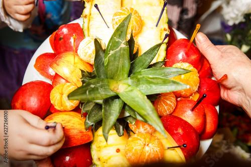 Fotografie, Obraz  sliced tropical fruits served on white plate
