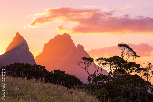 Foto auf Gartenposter Koralle Sunset beautiful Mauritius paradise landscape. Mauritius nature view of colorful sky and light of sun. Mountains with trees near Port Louis, Mauritius.