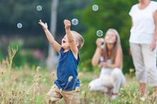 Happy Child With Family Having...