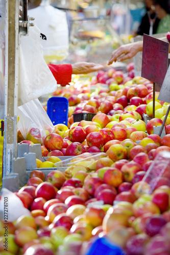 fresh apples on a farmer's market, healthy food, fruit, selective focus