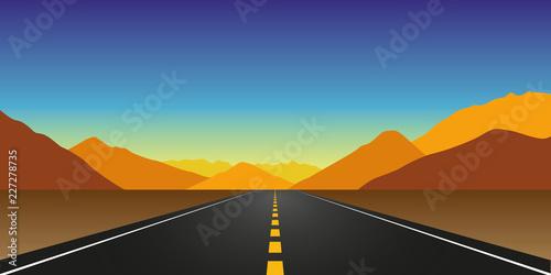 Obraz na plátně straight asphalt road in autumn in the mountains landscape