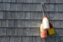 Old Lobster Floats Hanging On A Building Decoration