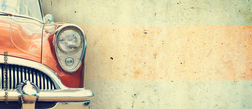 Poster Vintage cars The headlight of the old beautiful car on the background of a concrete wall. Copy space. Concept banners repair, sale of cars.