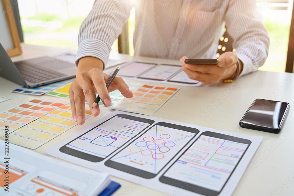 Fototapety, obrazy: UI Designer drawing website UX layout app development.